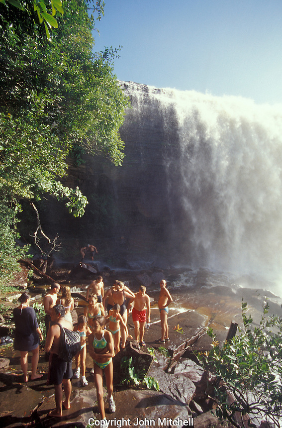 Tourists standing at the base of Salto El Sapo in Canaima National Park, Bolivar state, Venezuela