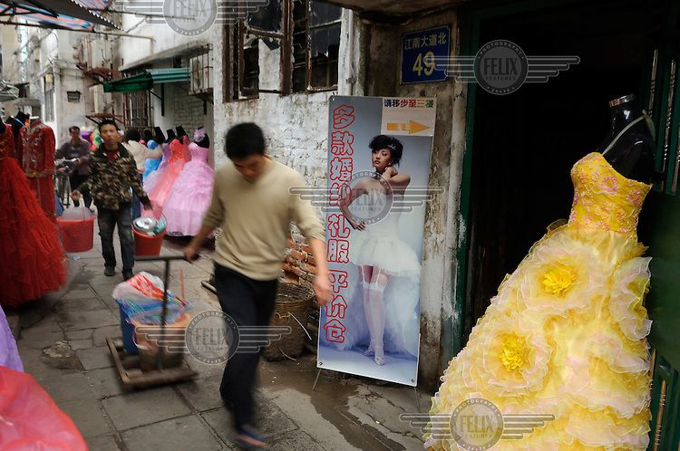 Man walking down an alley in the area of the wedding dress market.