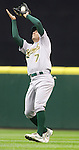 Oakland Athletics second baseman Adam Rosales catches a pop fly against the Seattle Mariners in the opening home game of the season at SAFECO Field in Seattle April 12, 2010. The Athletics beat the Mariners 4-0. Jim Bryant Photo. &copy;2010. ALL RIGHTS RESERVED.
