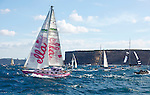 Jessica Watson, 16, crosses the finish line of her unassisted solo voyage around the world in her yacht Ella's Pink Lady S&S (Sparkman and Stephens) 34 at Sydney Harbour.