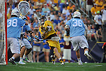 29 MAY 2011:  Tony Mendes (23) of Salisbury University unleashes a shot on goal against Patton Watkins (38) of Tufts University during the Division III Men's Lacrosse Championship held at M+T Bank Stadium in Baltimore, MD.  Salisbury defeated Tufts 19-7 for the national title. Larry French/NCAA Photos