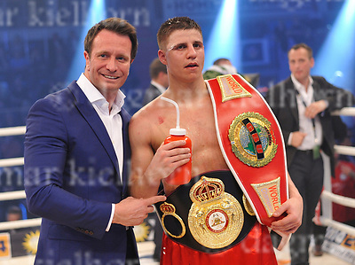 March 25-17,MBS Arena, Potsdam, Brandenburg, Germany<br /> WBA World super middleweight title<br /> Global Boxing Union World super middleweight title<br /> Super MiddleweightChampionship<br /> Tyron Zeuge,Berlin, Germany vs Isaac Ekpo ,Abuja, Nigeria<br /> Tyron Zeuge won by points with a fifth round technical decision over Isaac Ekpo-The fight was stopped due to injury, cut in round five.<br /> Winner with his promoter,Kalle Sauerland and belts.
