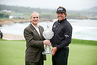 PEBBLE BEACH, CA--Phil Mickelson celebrates his win  at the AT&T Pebble Beach National Pro-Am Golf Championship at Pebble Beach Golf Links in Pebble Beach, CA on Sunday, February 12, 2012. Mickelson won the tournament with a total score of 269.