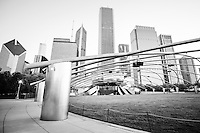 Pritzker Pavilion in Chicago black an white picture. Jay Pritzker Pavilion is an outdoor concert venue in downtown Chicago. Photo includes Grant Park, Millenium Park, Crain Communications building, Aon Center Building, Prudential Plaza, Prudential Tower, Aqua Building, and Blue Cross Blue Shield building.
