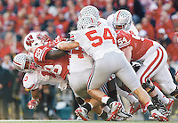 Badgers running back Montee Ball (28) is gang-tackled by OSU defenders, including Ryan Shazier (10) and John Simon (54).<br /> <br /> Eamon QueeneyDISPATCH