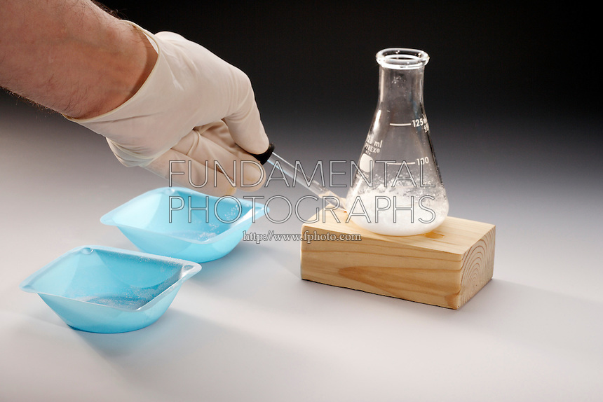 ENDOTHERMIC REACTION WITH Ba(OH)2 &amp; NH4SCN<br /> (6 of 8 - Variations Available)<br /> Moistening The Wood Under The Flask<br /> The two compounds in the flask, (BaO(H)2  &amp; NH4SCN, are mixed. The reaction occurs, creating a freezing slush that makes the flask bottom stick to the piece of moistened wood.