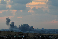 Smoke rises seconds after an Israeli airstrike against Hamas targets in Gaza. Israeli forces began an air offensive against Hamas in Gaza on 27/12/2008, which quickly escalated into an offensive by land, sea and air, in retaliation against Palestinian rockets fired into Israel. After eight days of bombardment, leaving over 400 Palestinians and four Israelis dead, Israeli tanks entered Gaza on 04/01/2009...