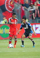 27 August 2011: San Jose Earthquakes midfielder Rafael Baca #30 and Toronto FC midfielder Julian de Guzman #6 in action during a game between the San Jose Earthquakes and Toronto FC at BMO Field in Toronto..The game ended in a 1-1 draw.