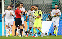 Spain goalkeeper Iker Casillas protests to referee Nicola Rizzoli claiming he was fouled by Robin Van Persie of Netherlands in the build up to the third Netherlands goal