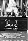 United States President Gerald R. Ford and Counsellor Robert Hartmann work on the President's upcoming speech before a Joint Session of Congress in the White House in Washington, D.C. on August 12, 1974.  <br /> Mandatory Credit: David Hume Kennerly / White House via CNP