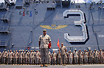 Sergeant Major Willie F. Metoyer, the highest ranking enlisted man in the 11th MEU stands at attention on the USS Belleau-Wood's flight deck backed by the 11th MEU's Command Element during the promotion ceremony that marks the beginning of each month.