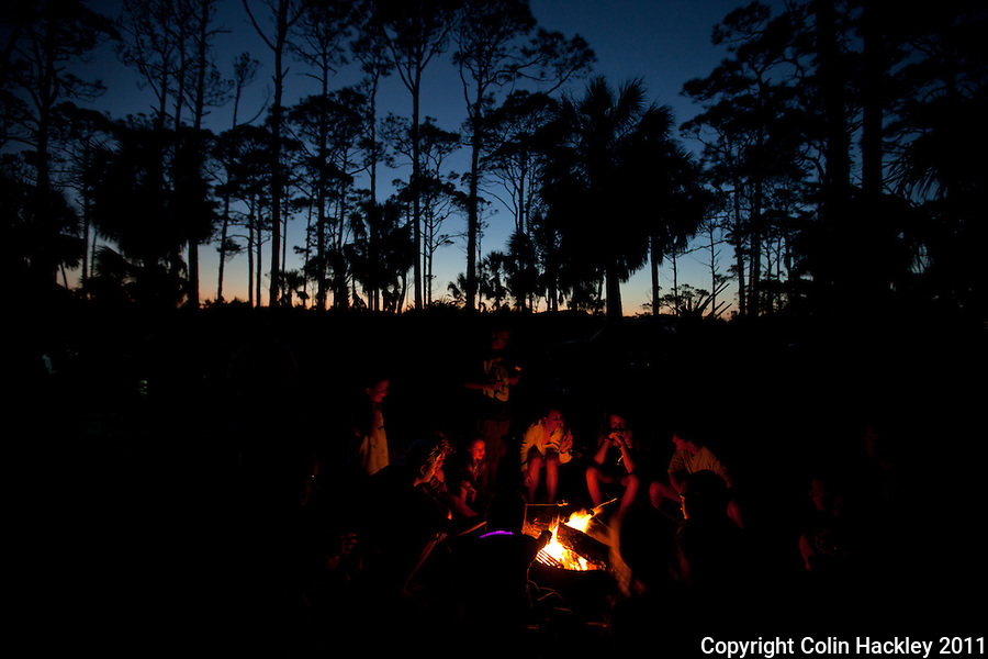 CAPE SAN BLAS, FLA. 4/9/2011-CAPESANBLAS040911 CH-Beneath the pines campers roast marshmallows around the fire at St. Joseph Peninsula State Park near Port St. Joe, Fla..COLIN HACKLEY PHOTO