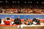 Helmets line the benches in the middle of the track before a bout between Hellcats and Putas del Fuego at the Palmer Events Center in Austin, Texas.