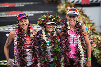 Rachel Joyce, Mirinda Carfrae and Liz Blatchford pose for the cameras at the 2013 Ironman World Championship in Kailua-Kona, Hawaii on October 12, 2013.