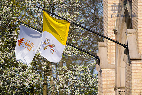April 18, 2017; Flags by the main door of the Basilica of the Sacred Heart (Photo by Matt Cashore/University of Notre Dame)