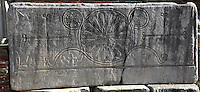 """Decorative Christian carving showing 2 crosses with floral motifs in circles and smaller winged crosses below, from the nave of the Basilica of St John, built 536-565 AD under Emperor Justinian on the site of the apostle's tomb, Ephesus, Izmir, Turkey. St John the Evangelist spent his last years in Ephesus and died here. In the 4th century a church was erected over his tomb but in the 6th century Justinian ordered the construction of a large, 6-domed basilica built of stone and brick with marble columns in a Greek cross plan, the ruins of which we see today. The church measures 130x56m and was an important Christian pilgrimage site, attaining the status of """"Church of the Cross"""". Originally, the church interior would have been covered with frescoes, and the vaults with mosaics. An earthquake in the 14th century destroyed most of the building. Ephesus was an ancient Greek city founded in the 10th century BC, and later a major Roman city, on the Ionian coast near present day Selcuk. Picture by Manuel Cohen"""