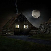 Old Icelandic farmhouse with the moon in the background.