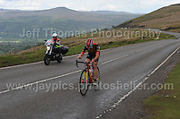 PRO team cyclists near the top of the challenging iconic and notorious 6km 10% stretch of road namely The Tumble during the Wales Velothon 2016 140km route cycling race. A lone competitor alongside a control motorcycle.  <br /> <br /> <br /> Jeff Thomas Photography -  www.jaypics.photoshelter.com - <br /> e-mail swansea1001@hotmail.co.uk -<br /> Mob: 07837 386244 -