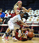 "Arkansas' Dominique Robinson (21), Mississippi's Valencia McFarland (3), and Arkansas' Calli Berna, back, go for a loose ball at the C.M. ""Tad"" Smith Coliseum in Oxford, Miss. on Thursday, January 12, 2012. (AP Photo/Oxford Eagle, Bruce Newman)"