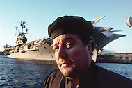 Manhattan, New York - October 5, 1988. French designer and architect Philippe Starck infront of an aircraft carrier.