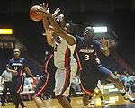 "Ole MIss' Nikki Byrd (22) is fouled by Ify Ibekwe (3) at the C.M. ""Tad"" Smith Coliseum in Oxford, Miss. on Thursday, November 18, 2010. Arizona won 72-70."