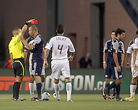 New England Revolution forward Rajko Lekic (10) discusses second yellow card (ejection) to New England Revolution midfielder Benny Feilhaber (22). In a Major League Soccer (MLS) match, the Philadelphia Union defeated the New England Revolution, 3-0, at Gillette Stadium on July 17, 2011.