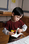 Berkeley CA Boy, four-years-old showing skill with scissors (half-Latino) MR