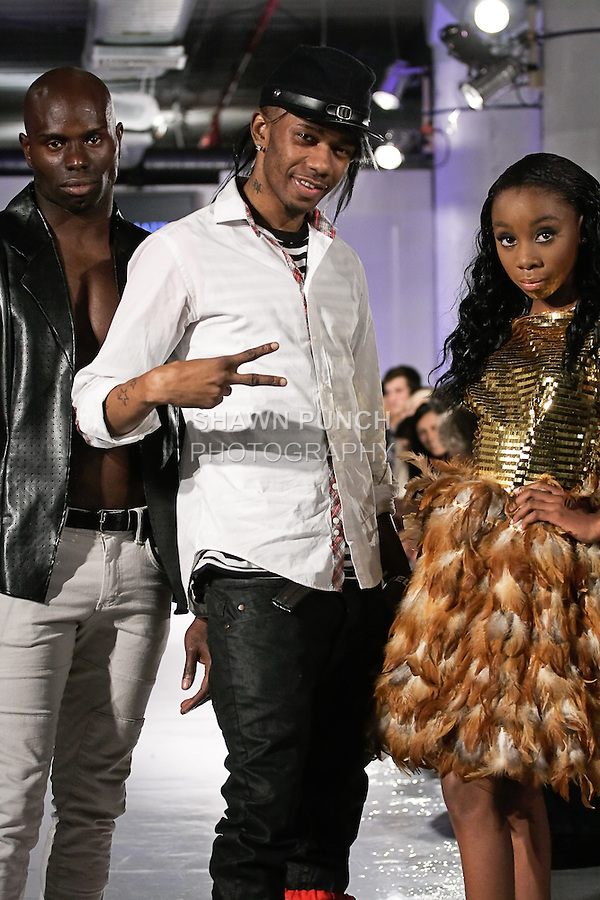 Fashion designer and stylist Dramatik Fanatic, walks the runway with models, at the close of his Dramatik Fanatic fashion show, during BK Fashion Weekend Spring Summer 2012.