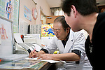 Dr. Kyohei Takahashi gives a consultation with a client at his clinic in Minami-Soma, Fukushima Prefecture, Japan on 08 April, 2011. With no other medical facilities operating in the area, Dr. Takahashi decided to stay behind and look after those who were either too elderly or sick to evacuate. .Photographer: Robert Gilhooly