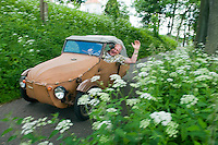 Giant Mountains, Northern Bohemia, Czech Republic, June 2010. Bert  van Kampen, owner of Camping Aktief in Vernorivice restored this 1970's Communist Socialist era Velorex vehicle. The area around Teplice, also known as the Broumovsky Steny, was inhabited by ethnic Sudeten Germans, that were deported after the Second World War. The rural landscape with green fields and cattle is dotted with little villages scarred by communist socialist architecture. Photo by Frits Meyst/Adventure4ever.com