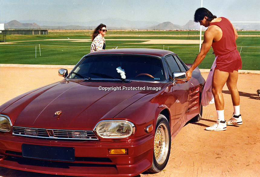 Oakland Athletics outfielder Jose Canseco getting in his candy apple red Jaguar at the A's spring training site in Arizona (1989 photo by Ron Riesterer)