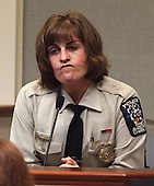 Montgomery County (Maryland) police officer, Cynthia Martin, the first officer on the scene of the shooting of sniper victim, Sarah Ramos, at the Leisure World Shopping Center in Silver Spring, Maryland, gives testimony in the trial of sniper suspect John Allen Muhammad at the Virginia Beach Circuit Court in Virginia Beach, Virginia on October 28, 2003. <br /> Credit: Adrin Snider - Pool via CNP
