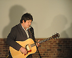 "Mark Ademac plays guitar as The Yoknapatawpha Arts Council held their inaugural ""Interaction"" event on Saturday, March 6, 2010. ""Interaction"" featured visual and performing arts from groups such as LaffCo!, Ballet Oxford, and Oxford Songwriters Association."