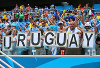 Uruguay supporters cheer their side on