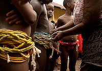 Young girls from the Krobo tribal group wear traditional waist beads as they undergo puberty rites - locally called dipo - in Somanya, Eastern Region, Ghana.