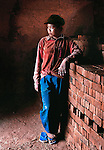 A girl resting after loading a trolley of bricks in a kiln in Sainyabuli province, Laos.