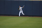 Ole Miss' Tanner Mathis (12) chases a ball in the second inning at Oxford University Stadium in Oxford, Miss. on Wednesday, February 23, 2011.
