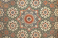 Coloured zellige tiles in geometric patterns in the Mausoleum of Moulay Ismail, or Moulay Ismail Ibn Sharif, reigned 1672ñ1727, second ruler of the Alaouite dynasty, built 1703 by Ahmed Eddahbi, Meknes, Meknes-Tafilalet, Morocco. Meknes is a fortified Imperial city redeveloped under Sultan Moulay Ismail, 1634-1727, as Morocco's political capital. Picture by Manuel Cohen