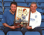 Ally McCoist and Walter Smith collect the Bell's player and manager of the month awards for August 1998