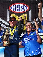 Jun 19, 2016; Bristol, TN, USA; NHRA funny car driver Tommy Johnson Jr (left) celebrates with sponsor Terry Chandler after winning the Thunder Valley Nationals at Bristol Dragway. Mandatory Credit: Mark J. Rebilas-USA TODAY Sports