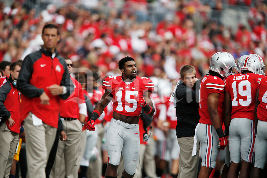 Ohio State Buckeyes running back Ezekiel Elliott (15) shown during a football game between The Ohio State University Buckeyes and the Kent State University Golden Flashes on Saturday, September 13, 2014 at Ohio Stadium in Columbus, Ohio. (Columbus Dispatch photo by Fred Squillante)