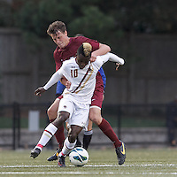Boston College midfielder Derrick Boateng (10) as Harvard University midfielder Kevin Harrington (21) closely defends.Boston College (white) defeated Harvard University (crimson), 3-2, at Newton Campus Field, on October 22, 2013.