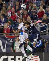 San Jose Earthquakes defender Justin Morrow (15) and New England Revolution defender Kevin Alston (30) battle for head ball. In a Major League Soccer (MLS) match, the San Jose Earthquakes defeated the New England Revolution, 2-1, at Gillette Stadium on October 8, 2011.