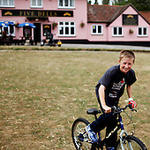 "Cavendish, Suffolk, Great Britain, July 2010:.Local boy riding bike by  ""Five Bells"" country pub. .(Photo by Piotr Malecki / Napo Images)..Cavendish, Suffolk, Wielka Brytania, Lipiec 2010:.Chlopiec na rowerze przed wiejskim pubem ""Five Bells"".. Fot: Piotr Malecki / Napo Images"