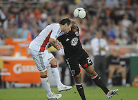 D.C. United forward Maicon Santos (29) heads the ball against New England Revolution defender A.J. Soares (5)   D.C. United defeated The New England Revolution 3-2 at RFK Stadium, Saturday May 26, 2012.