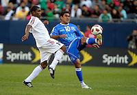 El Salvador's Eliseo Quintanilla plays the ball in front of El Salvador's Francisco Carrazana.  El Salvador defeated Cuba 6-1 at the 2011 CONCACAF Gold Cup at Soldier Field in Chicago, IL on June 12, 2011.