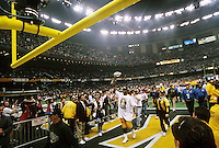 Green Bay packers defenseive end Reggie White walks off the field of the Superdome after the Green Bay Packers defeated the New England Patriots 35-21 in Super Bowl XXXI on January 26, 1997.