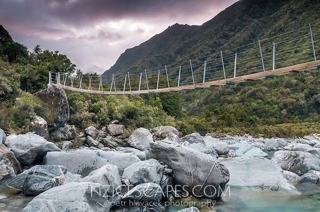 Butler River South Branch in Whataroa Valley and swingbridge at dusk, South Westland, West Coast, New Zealand