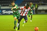 BARRANQUILLA - COLOMBIA - 18 - 04 - 2017: Jhonny Gonzalez (Der.) jugador de Atletico Junior disputa el balón con Ubaldo Luna (Izq.) jugador de Patriotas F.C. durante partido de la fecha 13 entre Atletico Junior y Patriotas F.C. por la Liga Aguila I-2017, jugado en el estadio Metropolitano Roberto Melendez de la ciudad de Barranquilla. / Jhonny Gonzalez (R) player of Atletico Junior vies for the ball with Ubaldo Luna (L) player of Patriotas F.C. during a match of the date 13 between Atletico Junior and Patriotas F.C. for the Liga Aguila I-2017 at the Metropolitano Roberto Melendez Stadium in Barranquilla city, Photo: VizzorImage  / Alfonso Cervantes / Cont.