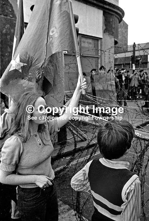 People's Democracy supporters are halted by soldiers and police from entering the city centre in Belfast, N Ireland. The march was in support of PD leaders Michael Farrell and Tony Canavan who were on hunger strike seeking political status in Belfast's Crumlin Road Jail. 29 July 1973, 197307290522g.<br /> <br /> Copyright Image from Victor Patterson, 54 Dorchester Park, <br /> Belfast, UK, BT9 6RJ<br /> <br /> t1: +44 28 9066 1296 (from Rep of Ireland 048 9066 1296)<br /> t2: +44 28 9002 2446 (from Rep of Ireland 048 9002 2446)<br /> m: +44 7802 353836<br /> <br /> e1: victorpatterson@me.com<br /> e2: victorpatterson@gmail.com<br /> www.victorpatterson.com<br /> <br /> Please see my Terms and Conditions of Use at www.victorpatterson.com. It is IMPORTANT that you familiarise yourself with them.<br /> <br /> Images used on the Internet must be visibly watermarked i.e. &copy; Victor Patterson<br /> within the body of the image and copyright metadata must not be deleted. Images <br /> used on the Internet have a size restriction of 4kbs and will be chargeable at current<br />  NUJ rates unless agreed otherwise.<br /> <br /> This image is only available for the use of the download recipient i.e. television station, newspaper, magazine, book publisher, etc, and must not be passed on to any third <br /> party. It is also downloaded on condition that each and every usage is notified within 7 days to victorpatterson@me.com<br /> <br /> The right of Victor Patterson to be identified as the author is asserted in accordance with The Copyright Designs And Patents Act (1988).